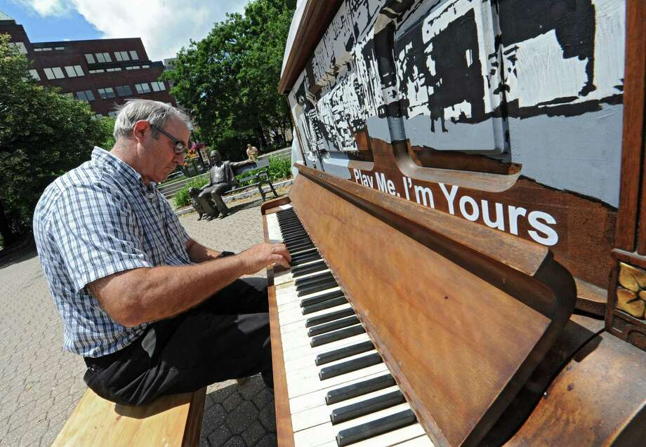 Wayne Mizerak plays a piano on Broadway on Thursday, June 26, 2014 in Albany, N.Y. The piano is one of 13 of the cityOs new Sculpture in the Streets exhibit organized by the Albany BID called OPlay Me IOm Yours.O (Lori Van Buren / Times Union) Photo: Lori Van Buren
