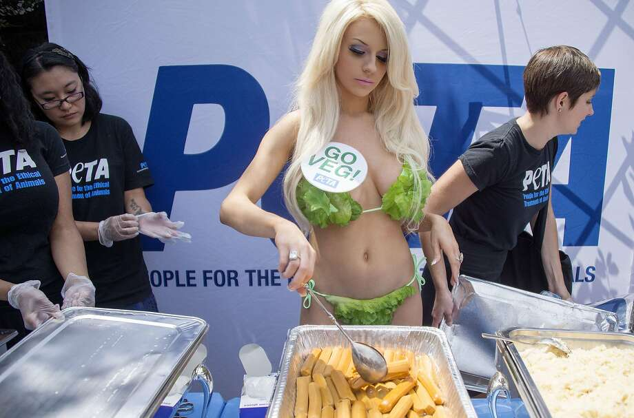 Lettuce dressing:Wearing bikini of healthy greens, model Courtney Stodden gets ready to serve free veggie hot dogs during   a PETA anti-meat promotion on Capitol Hill in Washington. Photo: Jim Watson, AFP/Getty Images