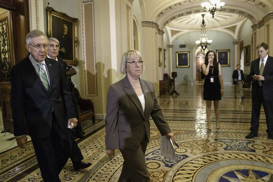 From left, Senate Majority Leader Harry Reid, D-Nev., Sen. Mark Udall, D-Colo., and Sen. Patty Murray, D-Wash., emerge from the Senate chamber after their effort to proceed on the ?Protect Women's Health From Corporate Interference Act,? was thwarted, on Capitol Hill in Washington, Wednesday, July 16, 2014. Sen. Murray and Democrats sponsored the election-year bill to reverse last month's Supreme Court ruling that closely held businesses with religious objections could deny coverage under President Barack Obama's health care law.  (AP Photo/J. Scott Applewhite) Photo: J. Scott Applewhite, Associated Press