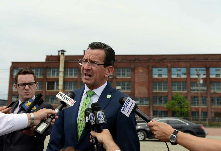 Gov. Dannel P. Malloy was in Bridgeport Wednesday, July 16, 2014, to announce funding for a new train station on Bridgeport's East Side. The State Bond Commission will approve $2.75 million for the design of a second train station to be built on the site of the former Remington Arms factory on the south side of Barnum Avenue which the state had previously given the city $2 million to demolish. Photo: Autumn Driscoll / Connecticut Post