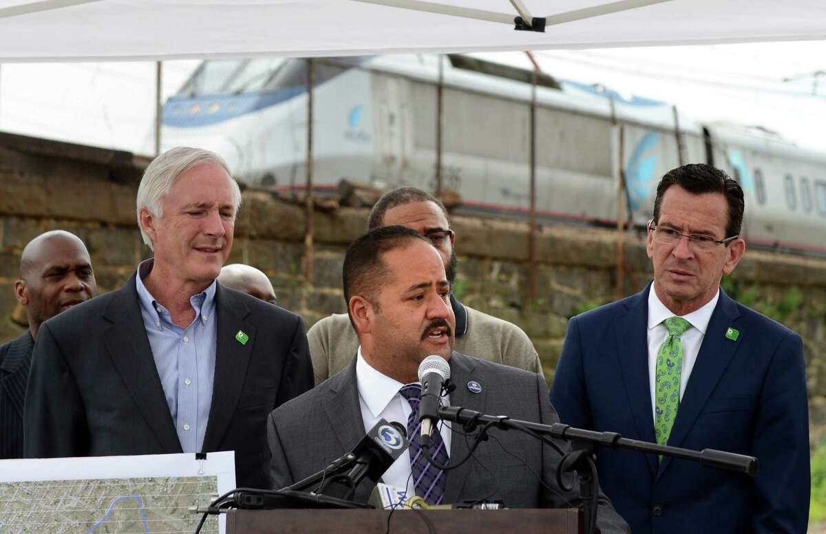 State Sen. Andres Ayala speaks Wednesday, July 16, 2014, during a press conference to announce funding for a new train station on Bridgeport's East Side. The State Bond Commission will approve $2.75 million for the design of a second train station to be built on the site of the former Remington Arms factory on the south side of Barnum Avenue which the state had previously given the city $2 million to demolish.