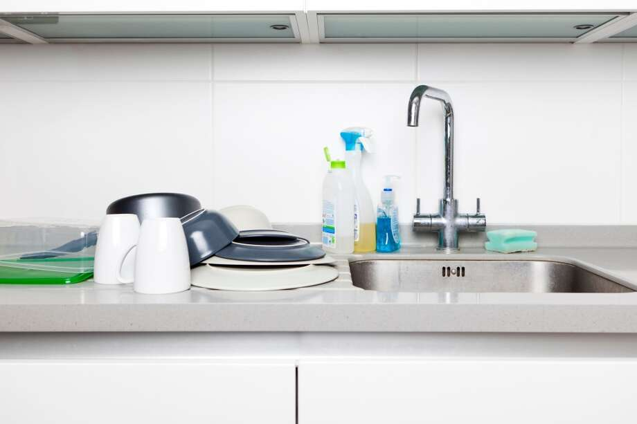Don't leave your dirty dishes in the kitchen for someone else to washThis is another food-related behavior to avoid. Make sure to clean up after you use plates, cups, utensils, or any other cooking equipment in your office. Photo: Image Source, Getty Images/Image Source