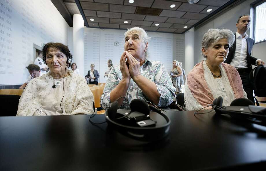 TOPSHOTS Bosnian women, members of the Srebrenica Mothers Association, wait prior to the announcement of the verdict in a court case against the Dutch government on July, 16 2014 in The Hague, Netherlands. The court ruled Wednesday that the Dutch state was liable for the deaths of over 300 victims of the Srebrenica massacre, the worst atrocity on European soil since World War II. Families of the victims had brought a case the Dutch government over the 1995 killings, accusing Dutch UN peacekeepers of failing to protect the 8,000 Muslim men and boys slaughtered by ethnic Serb troops just a few months before the end of the Bosnian war. AFP PHOTO / ANP / BART MAAT netherlands outBART MAAT/AFP/Getty Images Photo: Bart Maat, AFP/Getty Images