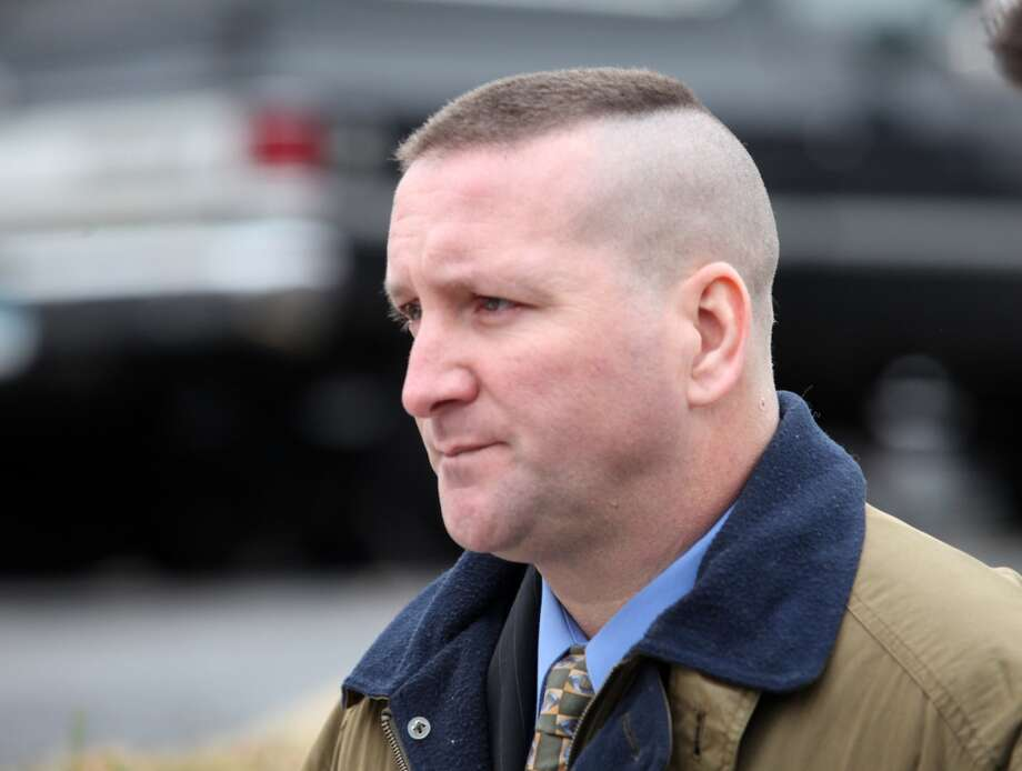 Connecticut State Police Trooper  Aaron Huntsman walks out of Bridgeport Superior Court after his arraignment on Monday, December 17, 2012. Photo: Unknown, B.K. Angeletti