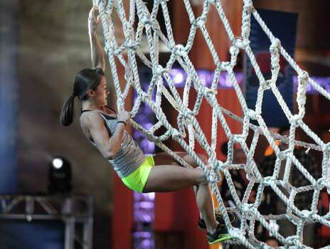 "Kacy Catanzaro — all 5 feet, 100 pounds of her — became summer's newest reality star when her run on NBC's ""American Ninja Warrior"" set the internet ablaze. The San Antonio athlete failed to make it past Stage 1 of the ""American Ninja Warrior"" finals in Las Vegas. Photo: Esquire Network, Esquire Network/NBCU Photo Bank / 2014 NBCUniversal Media, LLC"