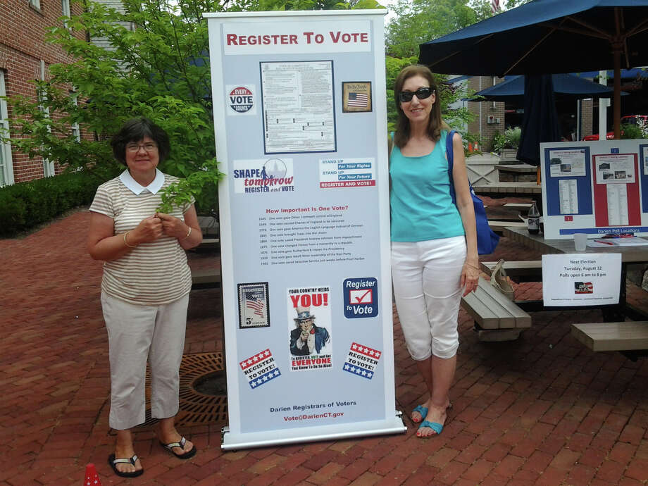 Clara Sartori, left, and Connie Bergen, both assistant registrars, stopped by a registration pop-up booth at the Darien Sidewalk Sales July 10 through 12. Photo: Contributed Photo, Contributed / Darien News Contributed