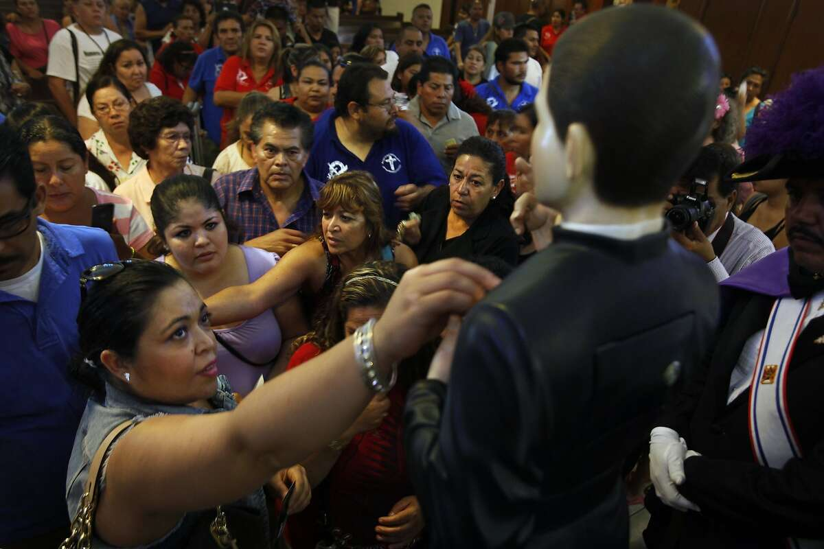 People gather for a mass at St. Marcelinus Catholic Church in Commerce, Calif., on July 7, 2014, to celebrate Santo Toribio Romo Gonzalez who they feel watches over immigrants. (Rick Loomis/Los Angeles Times/MCT)