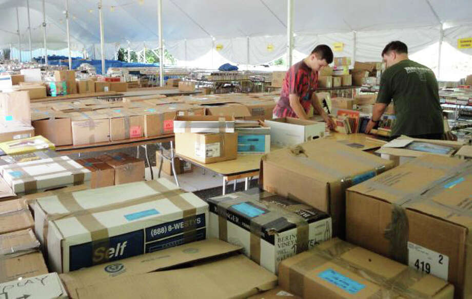 Every year volunteers spend hours preparing for the Pequot Library's Annual Book Sale, the library's largest annual fundraiser. This year, the sale begins on Friday, July25. Photo: Staff Photo / Fairfield Citizen