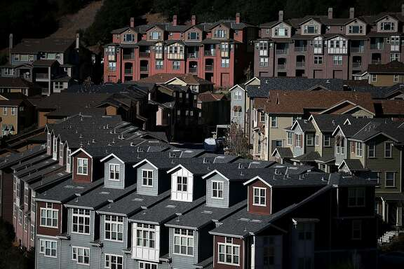 FILE - JUNE 24: According to reports June 24, 2014, new home sales surged in May by 18.6 percent, the largest one month gain since 1992. OAKLAND, CA - DECEMBER 04:  Rows of new homes line a street in a housing development on December 4, 2013 in Oakland, California. According to a Commerce Department report, sales of single family homes in the U.S. surged 25.4 percent in October, the larget gain in over 33 years. (Photo by Justin Sullivan/Getty Images)