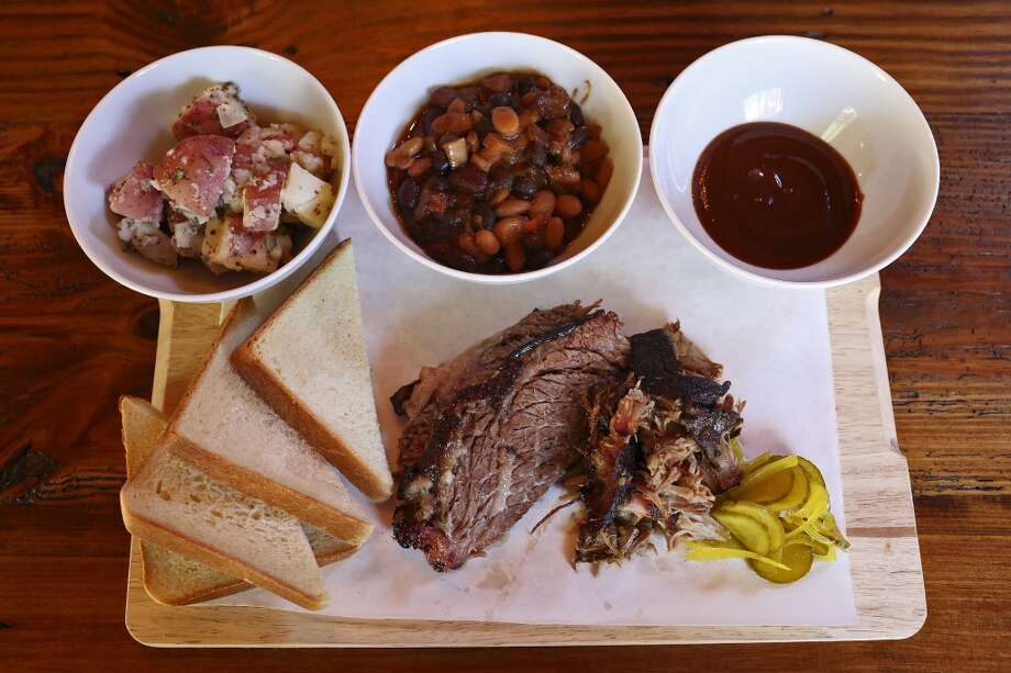 Barbecue Board: market style fare served with baked beans, potato salad, buttermilk bread, pickles and 'cue sauce, at The Granary in the Pearl Brewery complex in San Antonio on Wednesday, Jan. 30, 2013. Photo: San Antonio Express-News