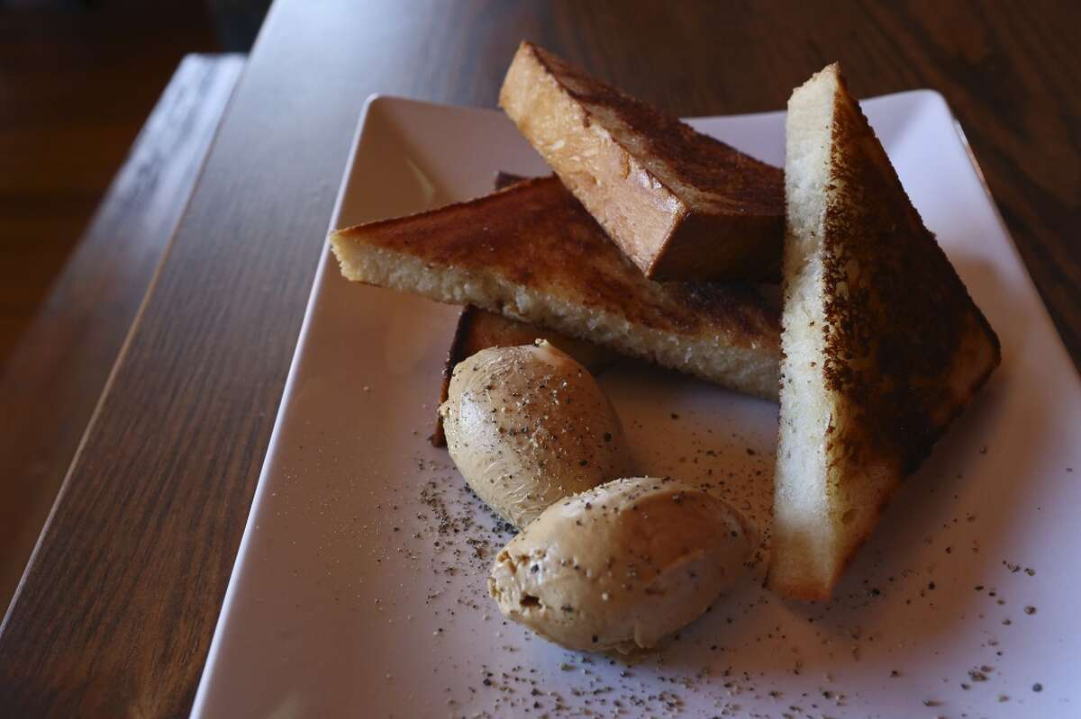 Texas Toast: buttermilk bread, barbecue butter and cracked black pepper, at The Granary 'Cue & Brew at The Pearl is mentioned in the November 2014 issue of Food & Wine magazine.