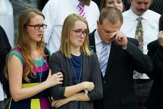 Cassidy Stay, center, leaves The Church of Jesus Christ of Latter-Day Saints with other mourners following funeral services for the six slain members of her family on Wednesday, July 16, 2014, in Houston. Ronald Lee Haskell is accused of killing the family members at their Spring home. Photo: Brett Coomer, Houston Chronicle / © 2014 Houston Chronicle