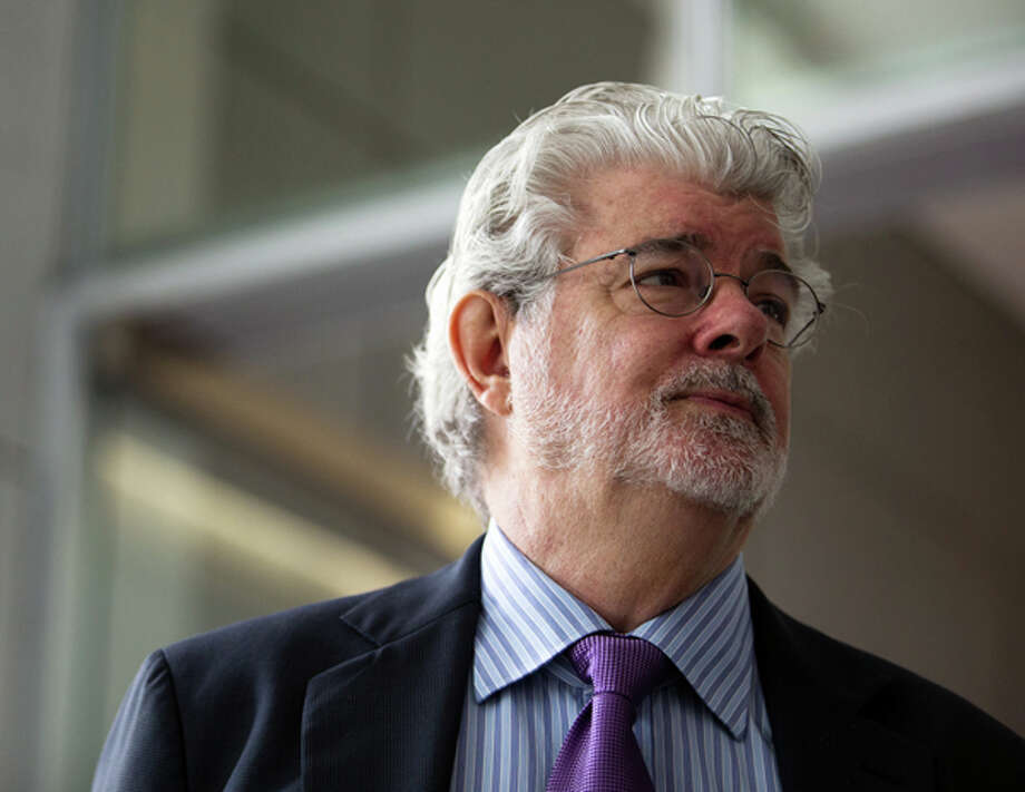 Billionaire George Lucas, filmmaker and founder of Lucasfilm Ltd., speaks during the opening ceremony of the company's Sandcrawler building, home to Lucasfilm's Singapore unit, in Singapore, on Thursday, Jan. 16, 2014. Lucasfilm Singapore, which is working on movies including Transformers 4 and Avengers 2, is expanding as it increases its workforce in the city-state, the only location outside the U.S. where the San Francisco-based company has a regional headquarters, it said. Photographer: Nicky Loh/Bloomberg via Getty Images Photo: Bloomberg Via Getty Images / © 2014 Bloomberg Finance LP