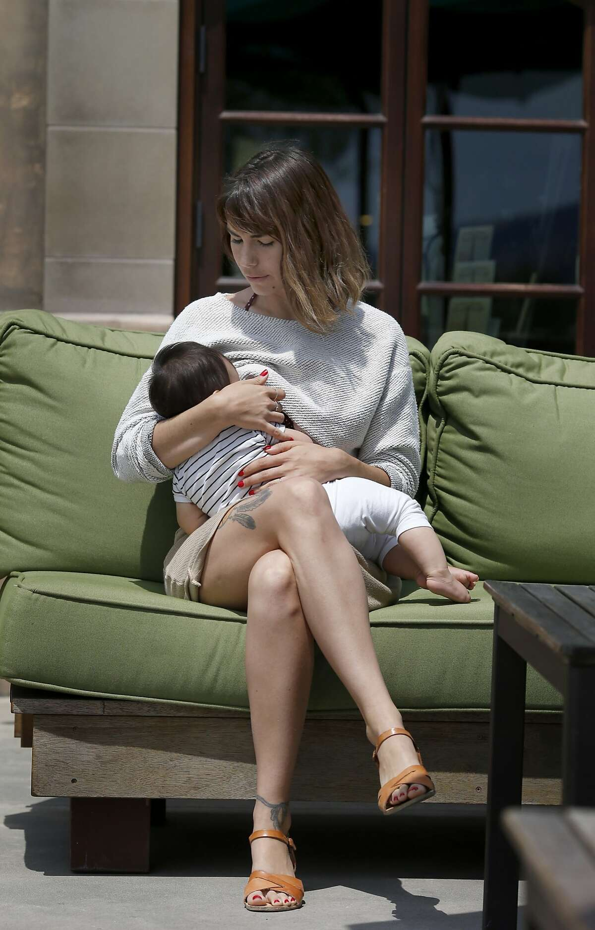 """Mandee Jaigirdar breastfeeds her daughter Lila during a visit to the wine country Wednesday July 16, 2014. Mandee Jaigirdar and other """"instagram Moms"""" are planning a protest at Instagram/FB headquarters stemming from photos of breastfeeding being removed from the picture website."""