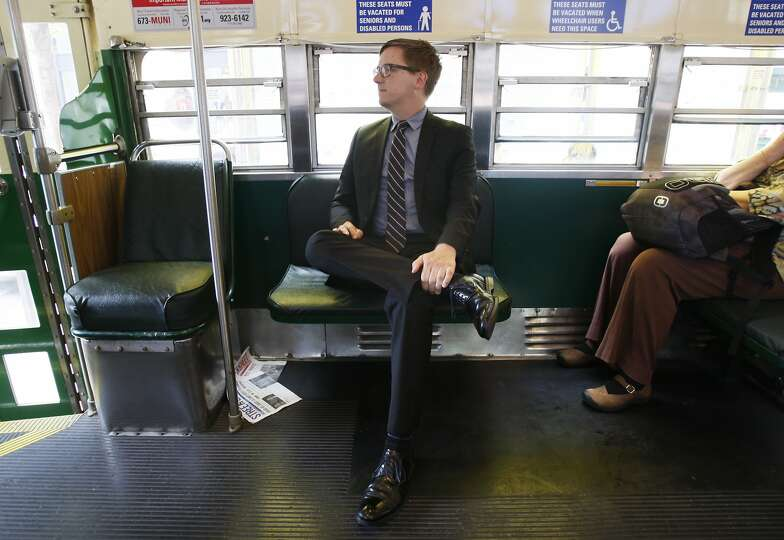 San Francisco Cultural Affairs Director Thomas DeCaigny rides a Muni streetcar while on his way to a meeting at City Hall on July 01, 2014 in San Francisco, CA.