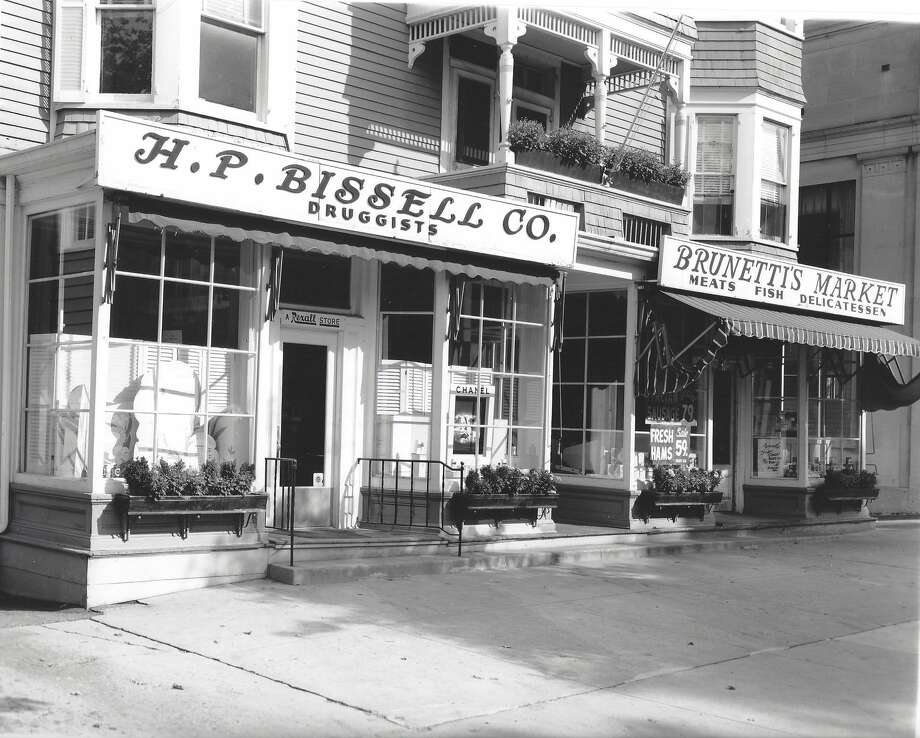 The Ridgefield Historical Society has donated photographs of storefronts circa 1964, which will be hang in the windows of several shops for the Chamber of Commerceís ìSummerfest 64î themed sidewalk sale Friday and Saturday. This photo shows the former Brunettiís Market and H.P. Bissell Druggist, currently Interiors & Design by Ursula and the Bissell House Restaurant. Photo: Contributed Photo / The News-Times Contributed