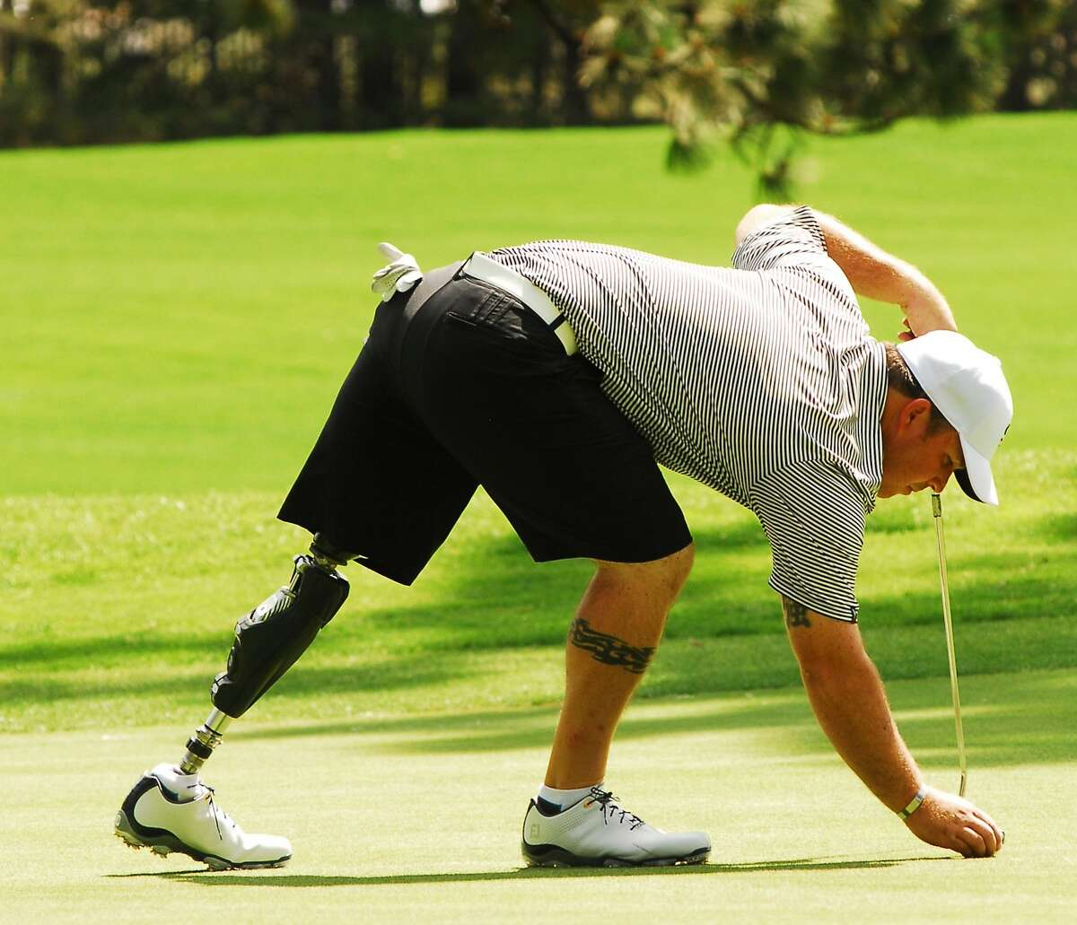 Chad Pfeifer places his ball for a putt in the Lake Tahoe Celebrity-Am on July 15, 2014 in Stateline, Nevada.