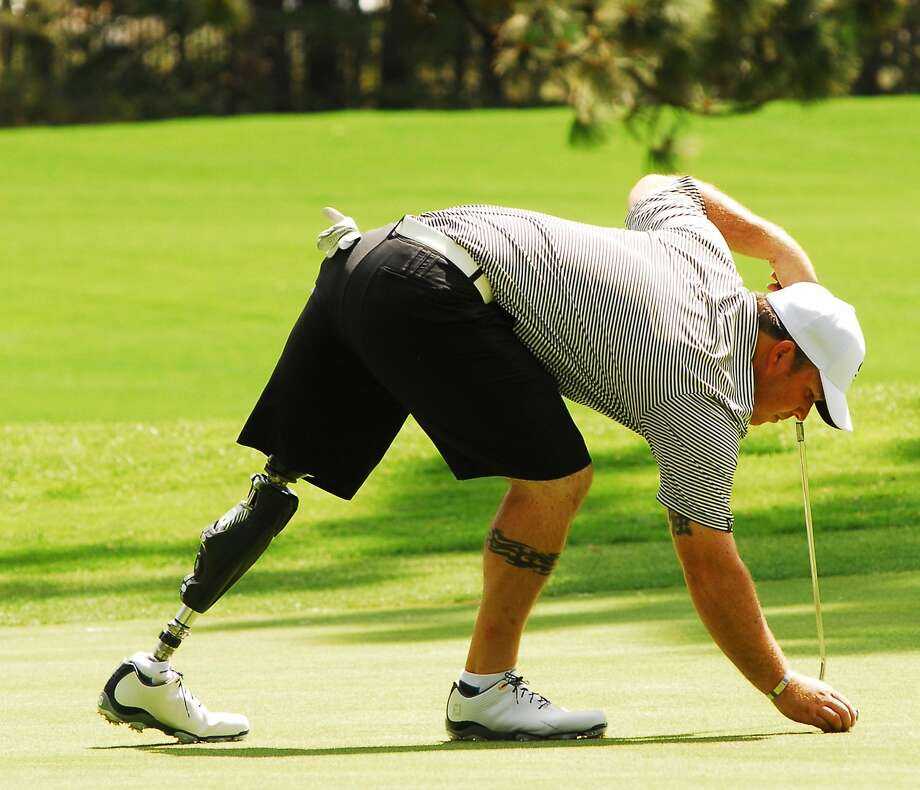 Chad Pfeifer first played golf after losing his leg to an improvised explosive device while serving in Iraq in 2007. Photo: Jeff Bayer, Special To The Chronicle