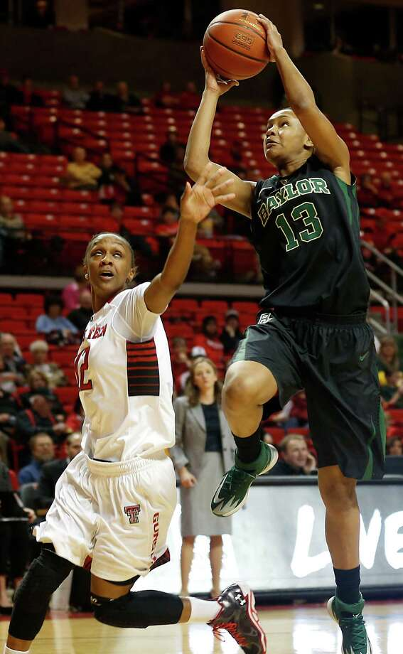 Baylor's Nina Davis, right, shoots over Texas Tech's Amber Battle during an NCAA college basketball game in Lubbock, Texas, Wednesday, Feb. 12, 2014. (AP Photo/The Avalanche-Journal, Tori Eichberger) Photo: Tori Eichberger, The Lubbock Avalanche-Journal / The Avalanche-Journal