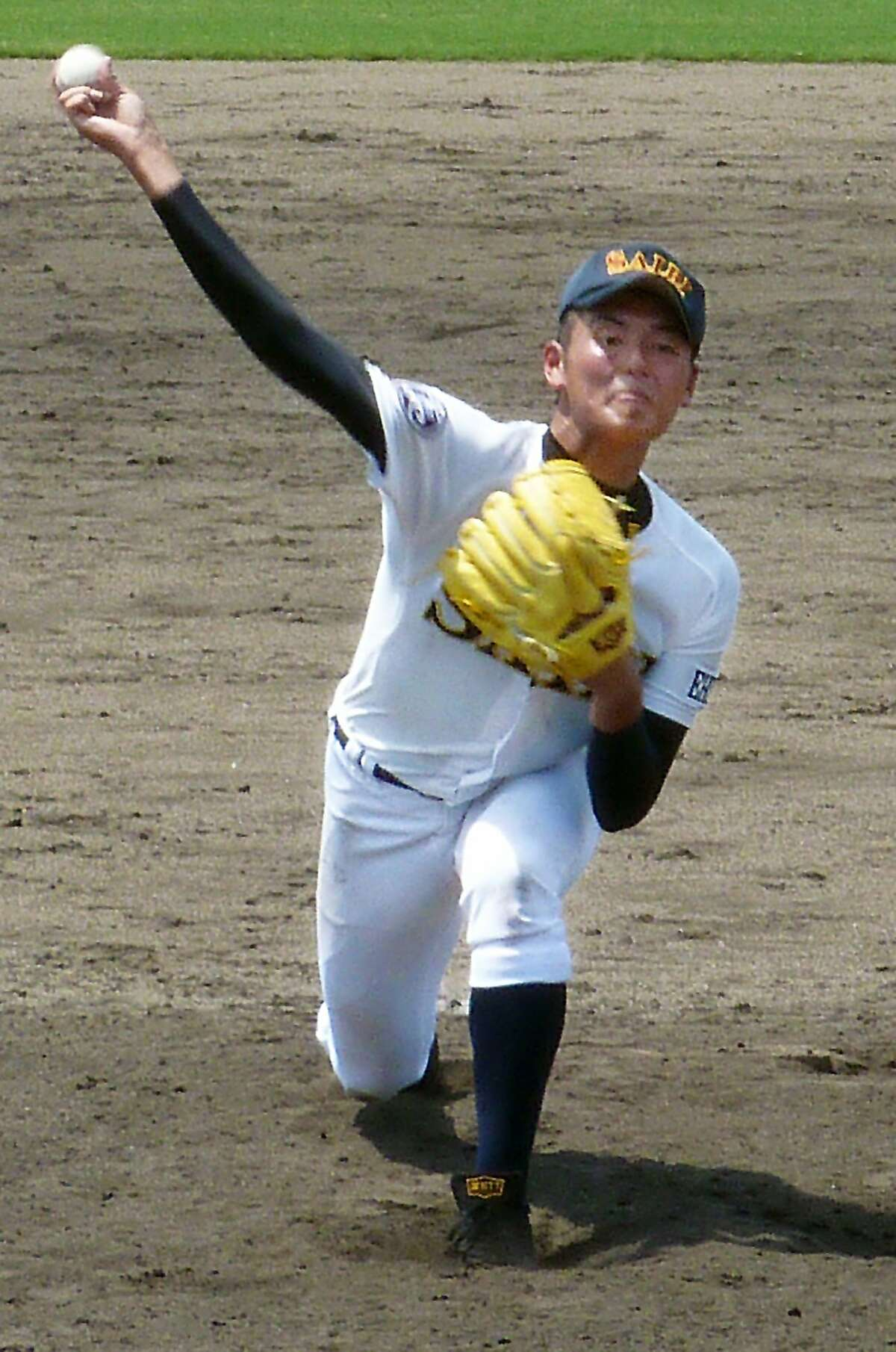 Saibi High School's Tomohiro Anraku delivers a pitch against Mishima High School in their baseball qualifying game in Saijo, southwestern Japan, Wednesday, July 16, 2014. Anraku, who many consider the future of Japanese baseball, took the mound and pitched a complete-game shutout an 8-0 win in the qualifying tournament for the summer tourney. The 17-year-old Anraku, who experienced pain in his right elbow last year, is no stranger to the type of marathon pitching performances that are legendary in Japanese high school baseball. Japan's High School Baseball Federation is considering introducing measures such as a tiebreaker and pitch counts limits in order to protect the health of the country's future stars. (AP Photo/Kyodo News) JAPAN OUT, CREDIT MANDATORYJAPAN OUT, CREDIT MANDATORY