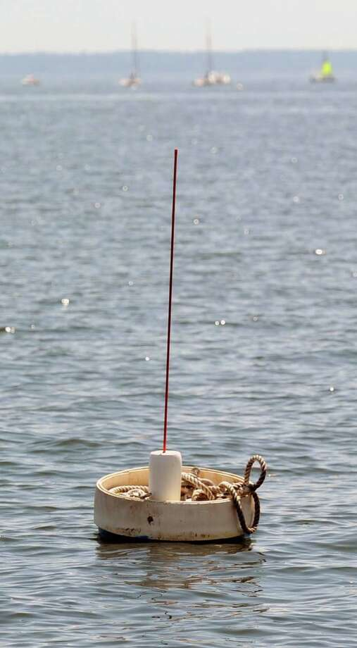 According to Greenwich Harbor Master Ian MacMillan, an unlawful mooring in a shellfish bed in the Long Island Sound off the coast of Greenwich Photo: Bob Luckey / Greenwich Time