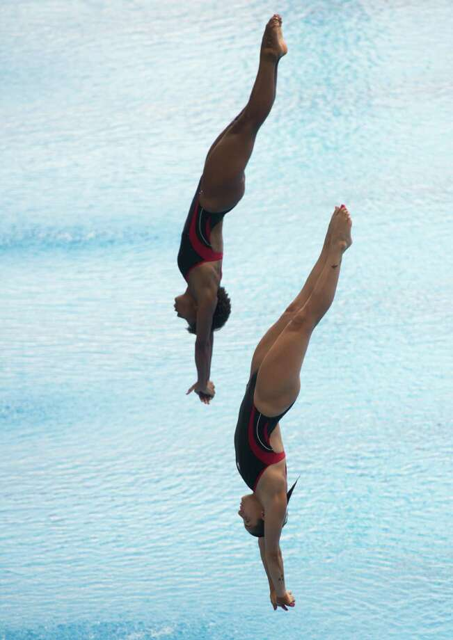 Canada's Pamela Ware (left) and Jennifer Abel dive in the Women's 3M Synchro Springboard Final during the 19th FINA Diving World Cup on July 16, 2014 in Shanghai. Photo: JOHANNES EISELE, AFP/Getty Images / AFP
