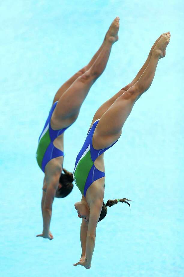 Francesca Dallape and Tania Cagnotto of Italy compete in the Women's 3m Springboard Synchro Final on day two of the 19th FINA Diving World Cup at the Oriental Sports Center on July 16, 2014 in Shanghai, China. Photo: Lintao Zhang, Getty Images / 2014 Getty Images