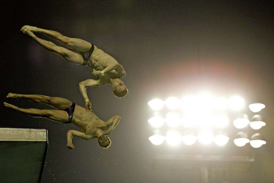 Lin Yue and Cao Yuan of China compete in the men's 10M Synchro Springboard Final on day two of the 19th FINA Diving World Cup at the Oriental Sports Center on July 16, 2014 in Shanghai, China. Photo: Lintao Zhang, Getty Images / 2014 Getty Images