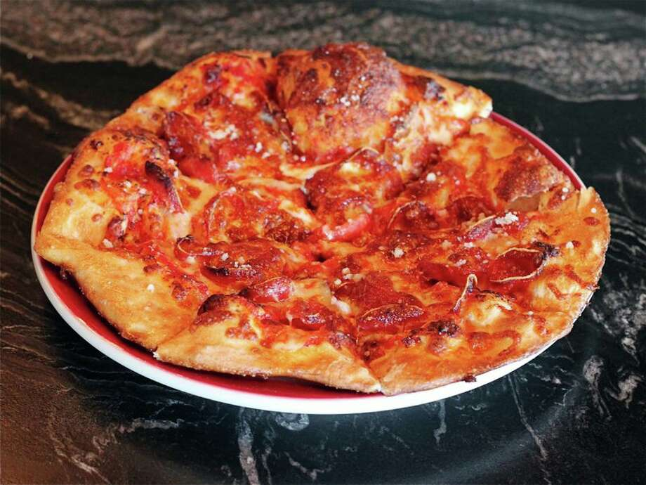 PHOTOS: Best places to eat in River Oaks and Upper KirbyLuna PizzeriaLocation: 3435 KirbyPhone: 832-767-6338For the thin-crust averse pizza fans, this pizzeria satisfies with sourdough crust pies. Salads and sandwiches round out the menu. Photo: Jill Ward