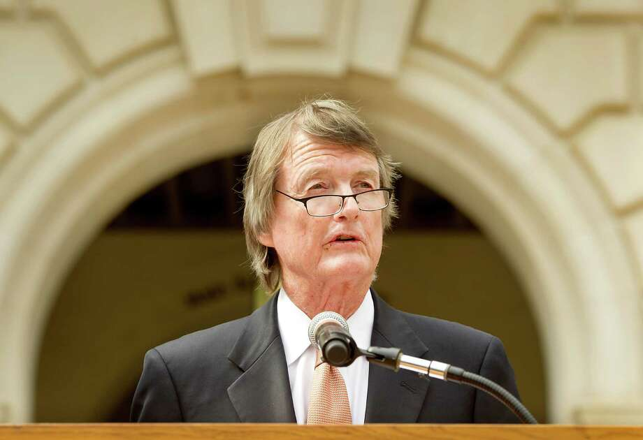 University of Texas President Bill Powers speaks to the media on Tuesday, July 15, 2014, on the south steps of the Main Tower in Austin, Texas. A federal appeals court panel ruled Tuesday that the University of Texas can continue using race as a factor in undergraduate admissions as a way of promoting diversity on campus, the latest in an ongoing case that made it to the U.S. Supreme Court last year only to be sent back to lower courts for further review. (AP Photo/Austin American-Statesman, Laura Skelding) Photo: Laura Skelding, MBO / Austin American-Statesman
