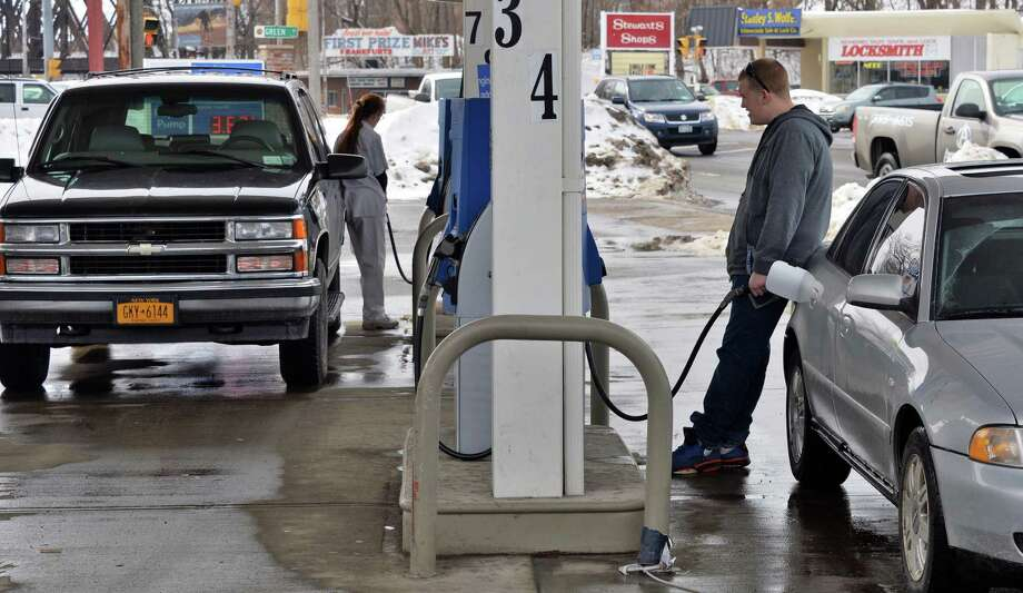 Motorists pump gas at the Country Farm convenience store on Erie Blvd. Thursday Feb. 20, 2014, in Schenectady, NY.  (John Carl D'Annibale / Times Union) Photo: John Carl D'Annibale / 00025840A