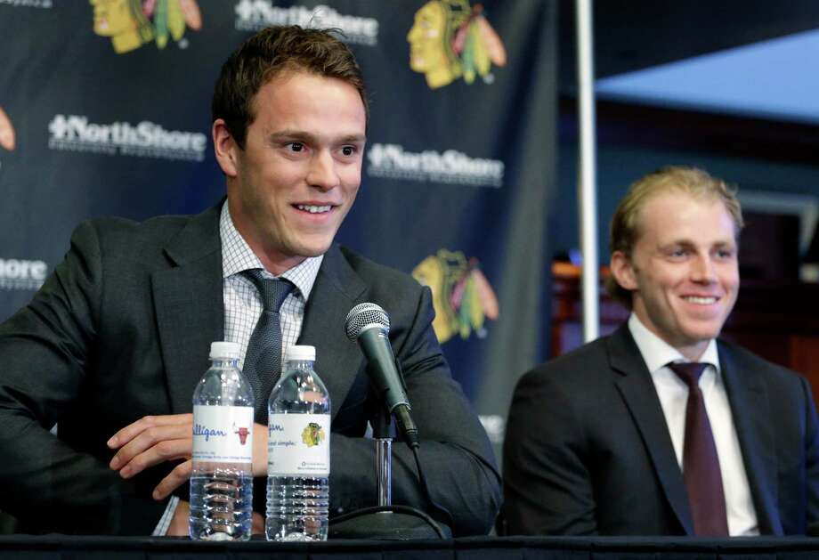 Chicago Blackhawks' Jonathan Toews, left, and Patrick Kane, smile as they listen to the media during a news conference at the United Center in Chicago, Wednesday, July 16, 2014. The Blackhawks recently agreed to eight-year contract extensions with for their star players. (AP Photo/Nam Y. Huh) ORG XMIT: CXA106 Photo: Nam Y. Huh / AP