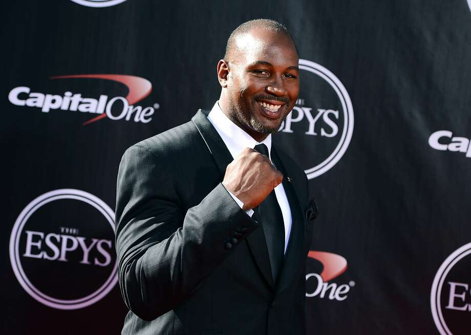 Former boxer Lennox Lewis arrives at the ESPY Awards at the Nokia Theatre on Wednesday, July 16, 2014, in Los Angeles. (Photo by Jordan Strauss/Invision/AP) Photo: Jordan Strauss, Associated Press
