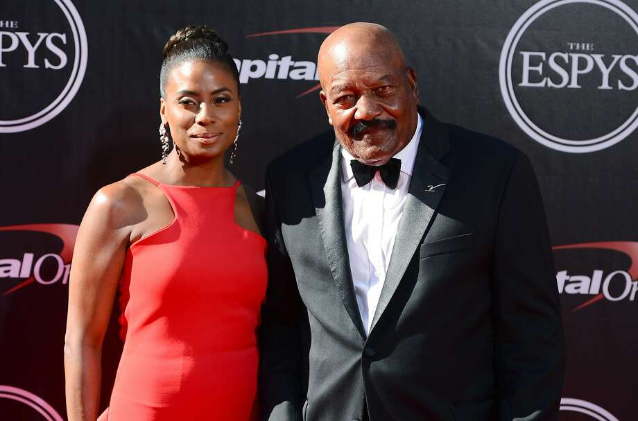 NFL legend Jim Brown, right, and Monique Brown arrive at the ESPY Awards at the Nokia Theatre on Wednesday, July 16, 2014, in Los Angeles. (Photo by Jordan Strauss/Invision/AP) Photo: Jordan Strauss, Associated Press