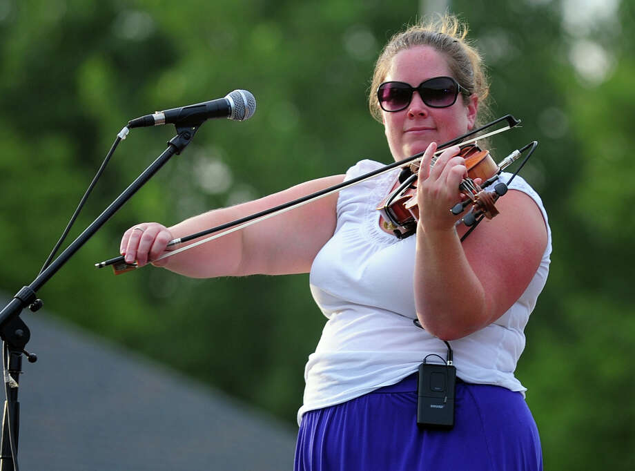 "Colleen Filush, with The Highland Rovers, performs during Shelton's ""Music Under the Stars"" concert series held at Riverwalk Park in Shelton, Conn. on Wednesday July 16, 2014. The next concert will be Gunsmoke on July 23rd from 7-9 p.m. Photo: Christian Abraham / Connecticut Post"