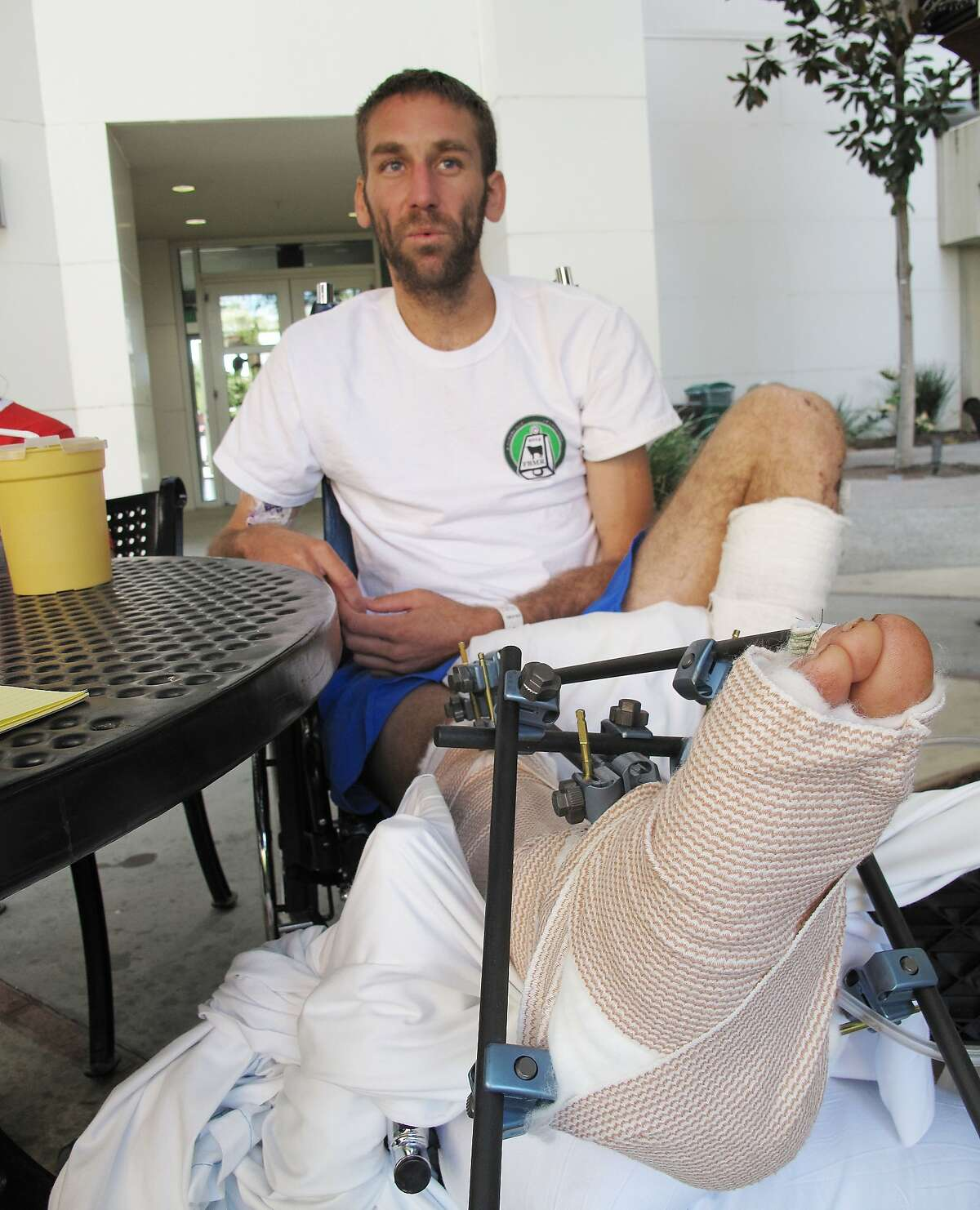 Gregg Hein, who broke his leg on a solo hike in the Sierra Nevada mountains, recovers at the Community Regional Medical Center in Fresno, Calif. on Wednesday, July 16, 2014. The 33-year-old hiker from Clovis, Calif., who was stranded for six days said that survival mode kicked in when he treated his own injury and he sought sustenance by eating crickets and moths, and drinking melting ice. (AP Photo/Scott Smith)