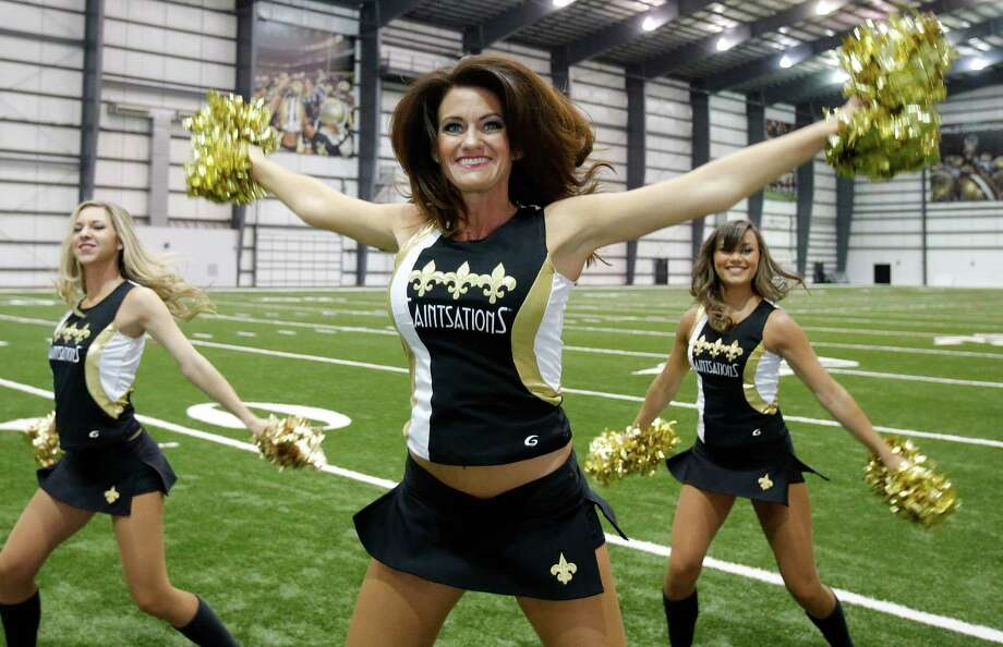 New Orleans Saints Saintsation Kriste Lewis performs during a photo shoot at the NFL football team's training facility in Metairie, La., Wednesday, July 16, 2014. Lewis is one of only two NFL cheerleaders in her 40s. The other dancer is 45-year-old Laura Vikmanis, who has been with the Cincinnati Bengals dance team, the Ben-Gals, since making the squad at age 40. (AP Photo/Bill Haber) ORG XMIT: LAWH112 Photo: Bill Haber / FR170136 AP