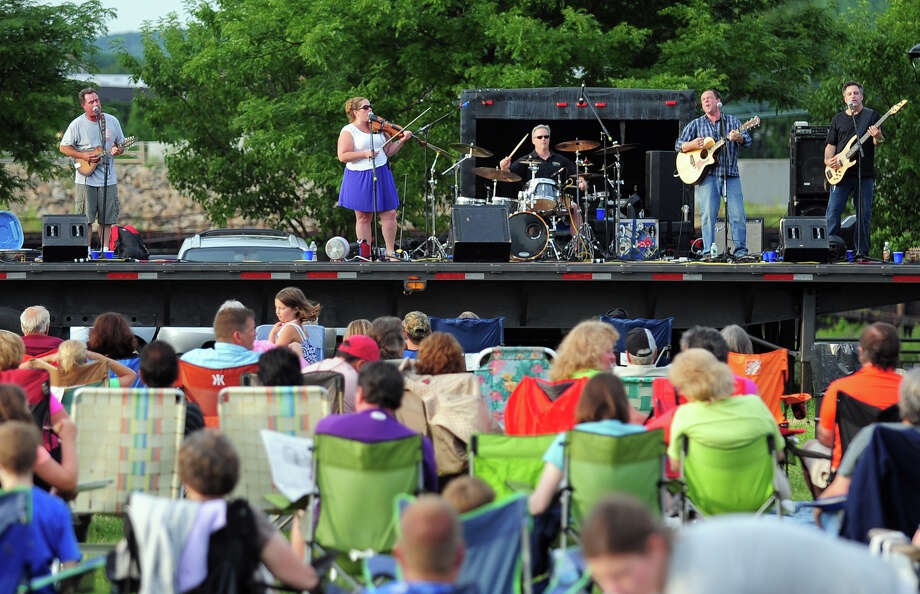 """The Highland Rovers perform during Shelton's """"Music Under the Stars"""" concert series held at Riverwalk Park in Shelton, Conn. on Wednesday July 16, 2014. The next concert will be Gunsmoke on July 23rd from 7-9 p.m. Photo: Christian Abraham / Connecticut Post"""