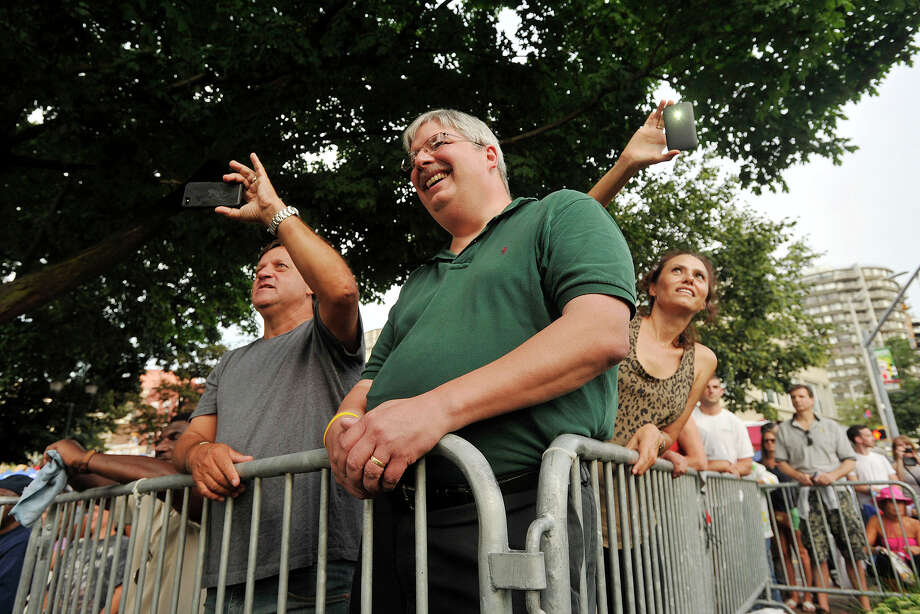 Alex Roldan, left, Dave Henderson, center, and Mariela Storti watch as B.B. King comes on stage during Jazz Up July at Columbus Park in Stamford, Conn., on Wednesday, July 16, 2014. Photo: Jason Rearick / Stamford Advocate
