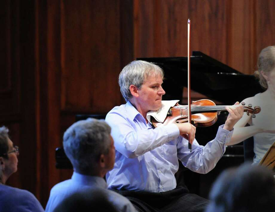 "Violinist, Krystof Witek of the Chamber Players of the Greenwich Symphony Orchestra, during the ""Sounds for a Summer Night"" performance at the Greenwich Arts Council at 299 Greenwich Ave., in Greenwich, Conn., Wednesday night, July 16, 2014. The evening's program included Haydn, Medtner, Panufnik and Brahms. Photo: Bob Luckey / Greenwich Time"