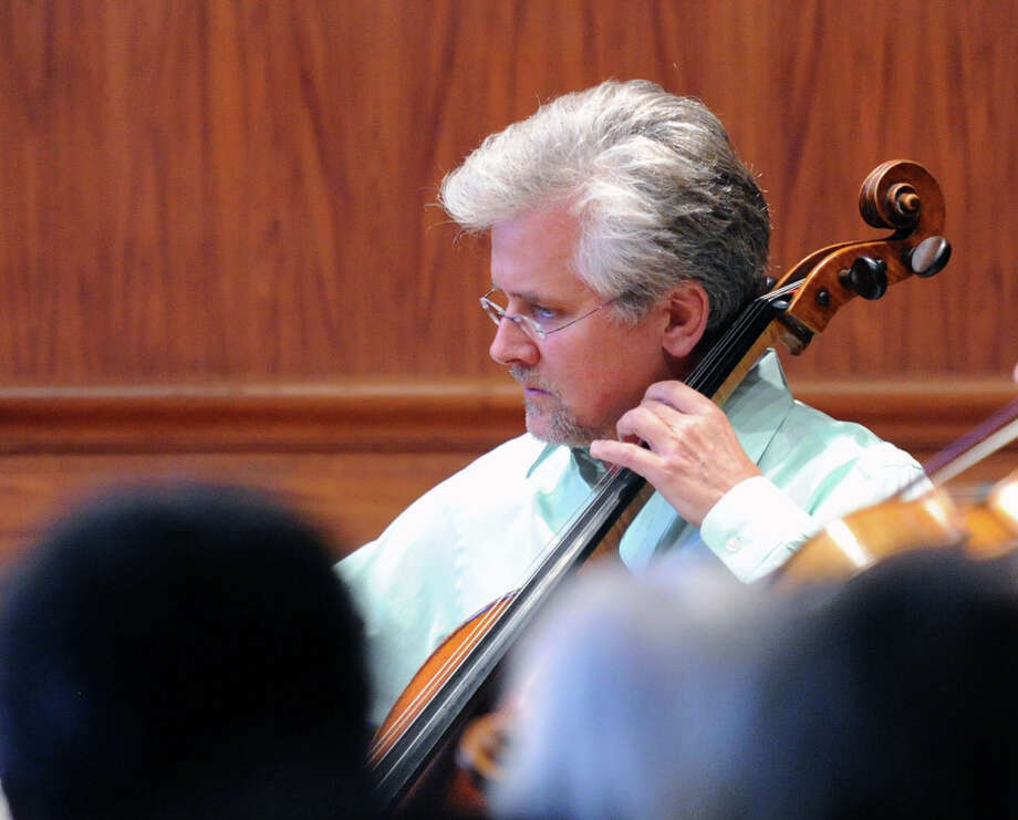 "Daniel Miller, plays his viola during the Chamber Players of the Greenwich Symphony Orchestra ""Sounds for a Summer Night"" performance at the Greenwich Arts Council at 299 Greenwich Ave., in Greenwich, Conn., Wednesday night, July 16, 2014. The evening's program included Haydn, Medtner, Panufnik ande Brahms. Photo: Bob Luckey / Greenwich Time"