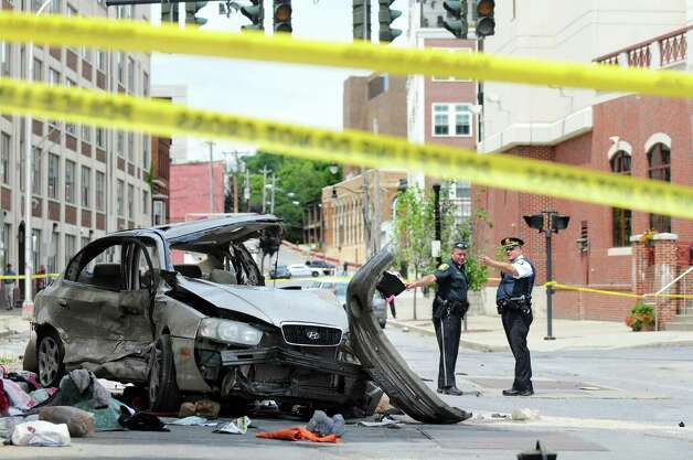 Albany Police officers investigate a crash scene on Sheridan Avenue near Chapel Street on Wednesday, July 16, 2014, in Albany, N.Y. (Cindy Schultz / Times Union) Photo: Cindy Schultz