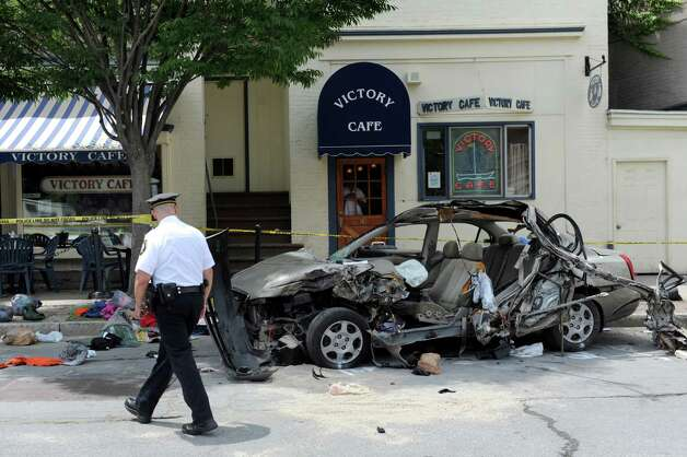 Special Operations Lieutenant Paul Kirwan investigates a crash on Sheridan Avenue near Chapel Street on Wednesday, July 16, 2014, in Albany, N.Y. (Cindy Schultz / Times Union) Photo: Cindy Schultz