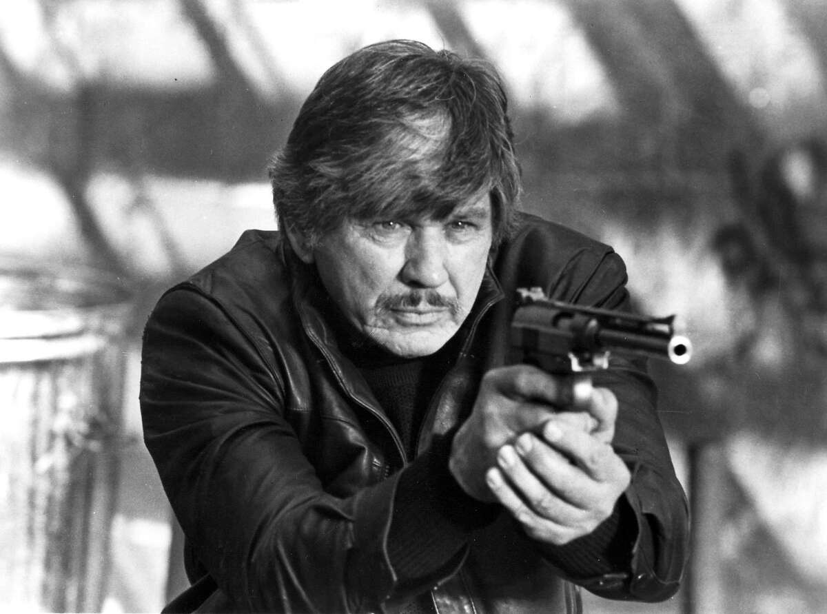 """Action star Charles Bronson has died, according to reports August 31, 2003. He was 81. Bronson is shown as he portrays architect Paul Kersey who fights street crime in New York City in a scene from the 1985 film """"Death Wish 3."""" (BW ONLY, NO SALES) REUTERS/Files Country troubadour Johnny Cash inspired the hearts, minds and souls of millions; he is pictured at a 1976 concert in San Francisco. also ran 12/28/03"""
