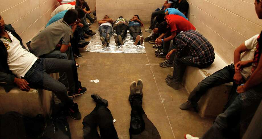 MCALLEN, TX. --TUESDAY,  JULY 15, 2014 -- Immigrants who have been detained while crossing the border  are held inside the McAllen Border Patrol Station in McAllen, Texas, Tuesday July 15, 2014.   More than 350 detainees were being held  on Tuesday, July 15, 2014, at the station.  A solution for the growing crisis of tens of thousands of unaccompanied children showing up at the U.S.-Mexico border is looking increasingly elusive with three weeks left before Congress leaves Washington for an annual August recess.    (AP Photo/Los Angeles Times, Rick Loomis, Pool) ORG XMIT: CALOS133 Photo: Rick Loomis / Los Angeles Times,Pool