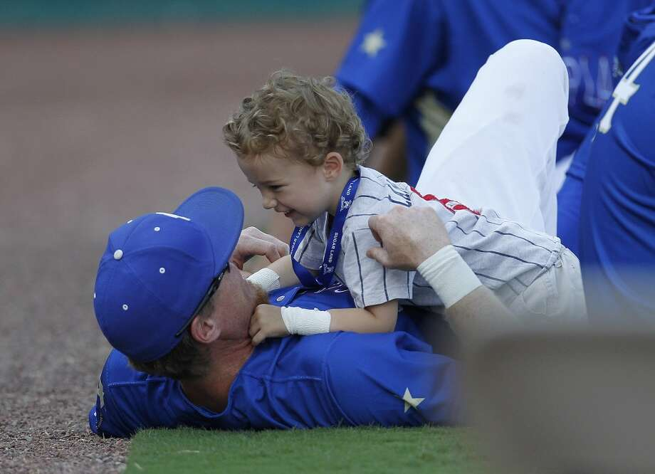 Skeeters Chase Lambin plays with his son, Champ Lambin 2 1/2, during the home run derby during the Atlantic League All-Star game at Constellation Field, Wednesday, July 16, 2014, in Sugar Land. ( Karen Warren / Houston Chronicle  ) Photo: Karen Warren, Houston Chronicle