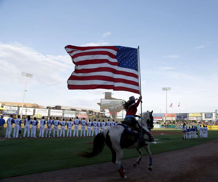 The American flag is ridden around the field before the start of the Atlantic League All-Star game at Constellation Field, Wednesday, July 16, 2014, in Sugar Land. ( Karen Warren / Houston Chronicle  ) Photo: Karen Warren, Houston Chronicle