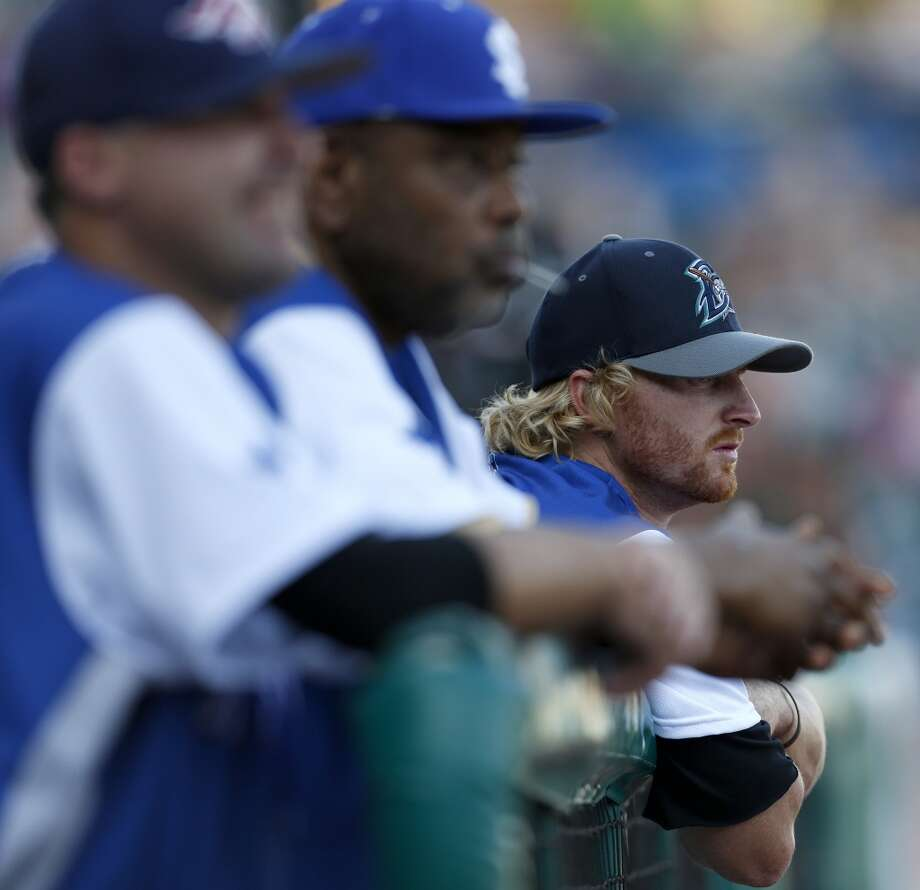 Former Houston Astro J.R. Towles, now with Bridgeport, watches the game from the dugout during the Atlantic League All-Star game at Constellation Field, Wednesday, July 16, 2014, in Sugar Land. ( Karen Warren / Houston Chronicle  ) Photo: Karen Warren, Houston Chronicle
