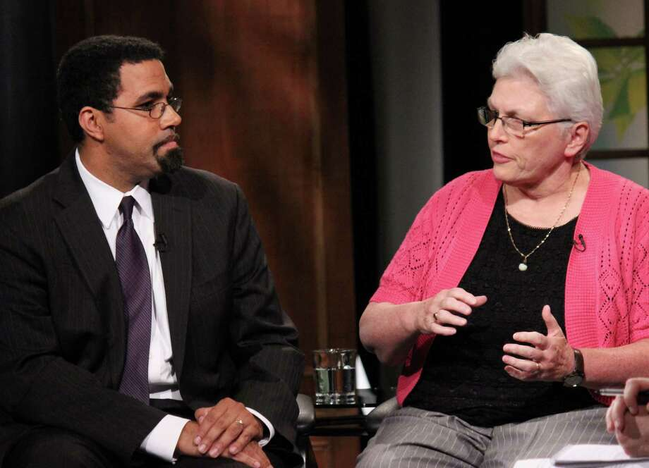 State Education Commissioner John King, left, and Voorheesville Superintendent Dr. Teresa Thayer Snyder, right, discuss educational issues at the WMHT event hosted by the Times Union on Wednesday evening, July 16, 2014, in Troy N.Y. (Selby Smith/Special to the Times Union) Photo: Selby Smith / 00027816A