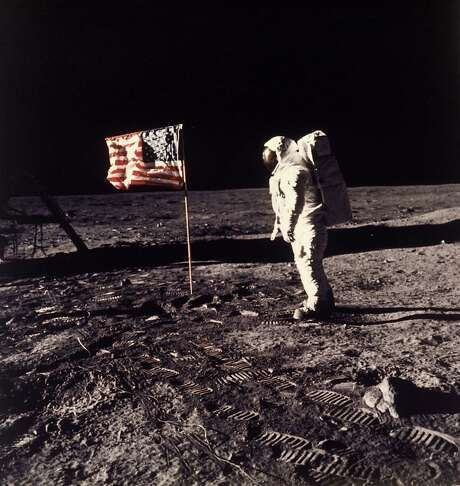 "Astronaut Edwin E. ""Buzz"" Aldrin Jr. poses beside the U.S. flag on the moon during the Apollo 11 mission on July 20, 1969. A 45th anniversary ceremony is planned Monday at Kennedy Space Center in Florida. Photo: Neil Armstrong / Associated Press / NASA"